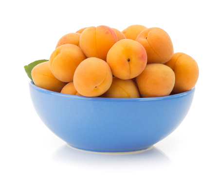 apricot in bowl isolated on white background photo