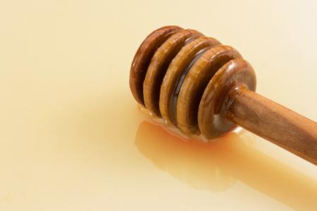 honey and stick isolated on white  photo