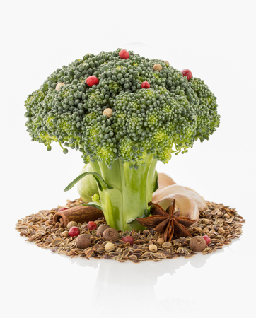 broccoli and spices isolated on white background photo