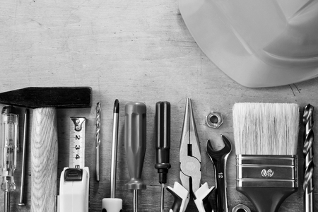 set of construction tools and instruments on wood background photo