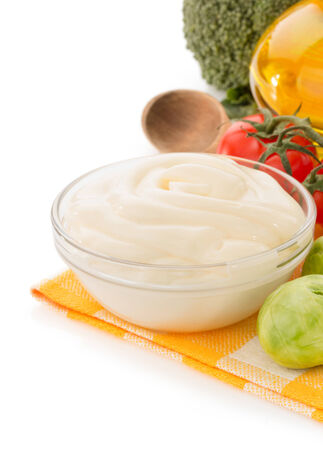 mayonnaise sauce in bowl isolated on white background photo