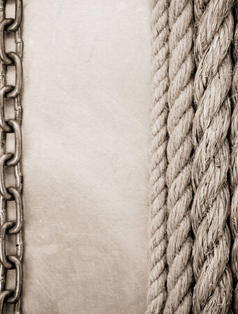 chain and ship rope on metal texture background photo
