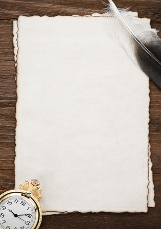 ink pen and watch on parchment background texture photo