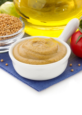 mustard sauce in bowl isolated on white background photo