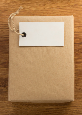 parcel wrapped packaged box on wooden background photo