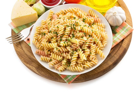 pasta fusilli in plate isolated on white background photo