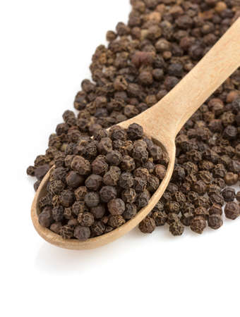 black pepper: pepper in spoon isolated on white background