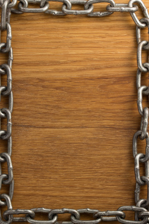 metal chain on wooden background photo