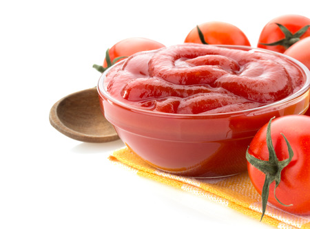tomato sauce in bowl isolated on white background photo