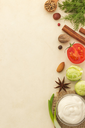 food ingredients and spices on aged background photo
