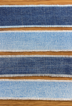 jeans strips at wooden texture background photo