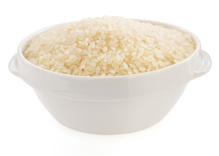 rice in bowl isolated on white background photo