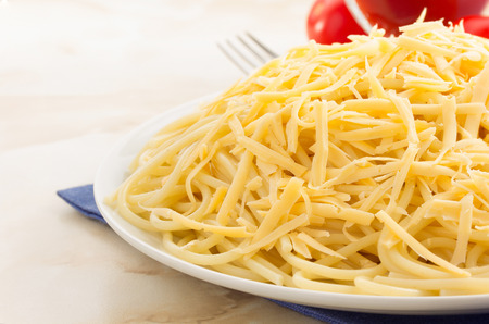 pasta spaghetti macaroni on wooden background photo