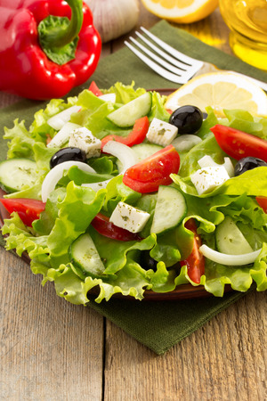 salad in plate on wooden background photo