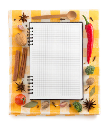 food ingredients and recipe book on white background photo