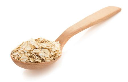 oat flakes in spoon on white background Standard-Bild