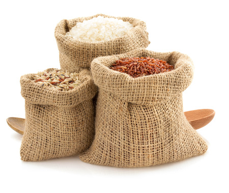 rice in sack bag on white background Reklamní fotografie