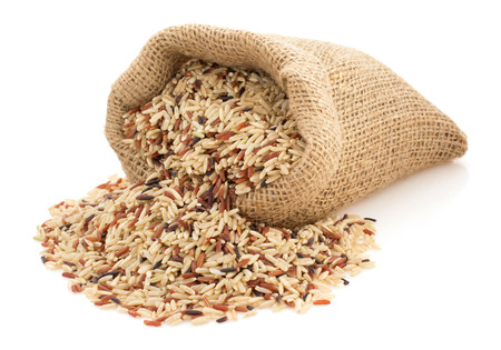 rice in sack bag on white background Standard-Bild
