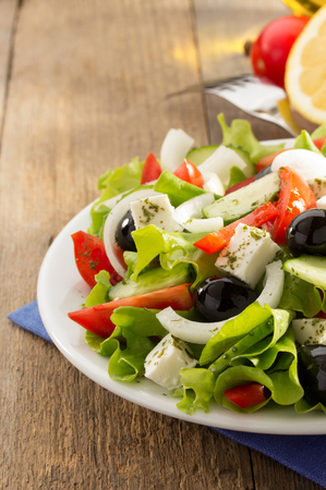 greek salad on wooden background photo