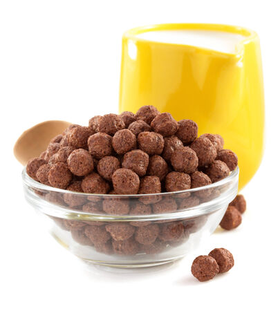 cereal chocolate balls  in bowl  on white background photo