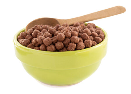 cereal chocolate balls in bowl isolated on white background photo