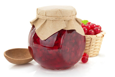 red currant jam on white background photo