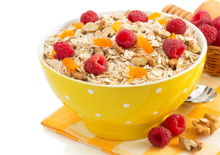 bowl of cereals muesli isolated on white background photo