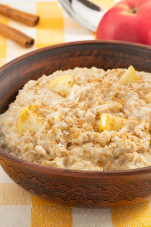 ear checked: bowl of oatmeal on tablecloth background Stock Photo