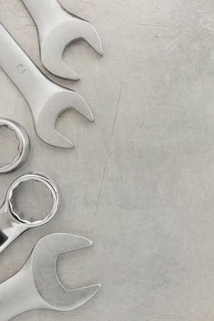 wrench tools at metal background photo