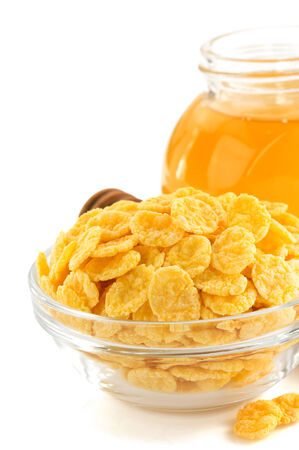 corn flakes in bowl isolated on white background photo