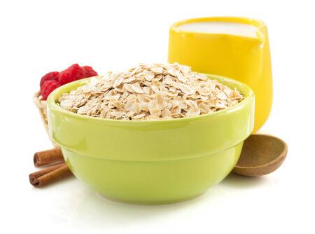 bowl of oat flake isolated on white background photo
