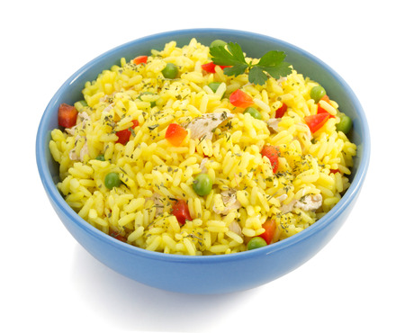 bowl full of rice isolated on white background photo