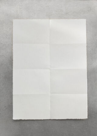 ripped paper background: folded note paper at metal background