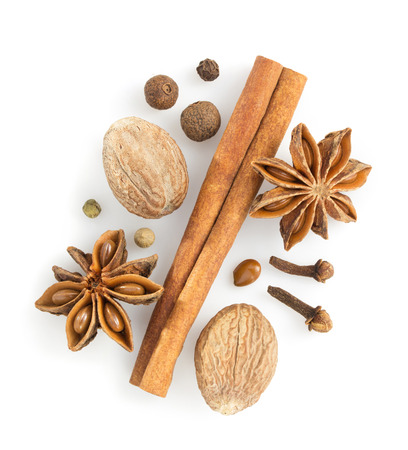 cinnamon sticks, anise star and nutmeg on white background photo