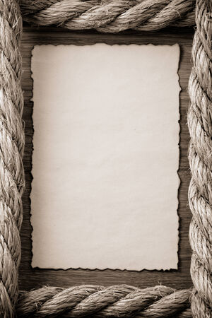 rope border: ropes and old vintage ancient paper at wooden background