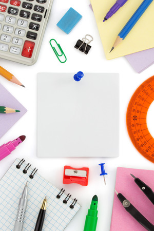 school supplies and note paper on white background photo