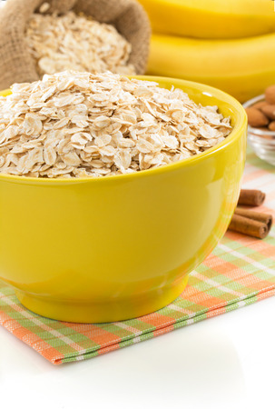 ear checked: bowl of oat flake isolated on white background