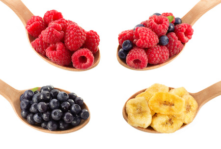 fruit and berry in spoon on white background photo