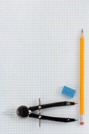 pencil at checked paper background texture photo