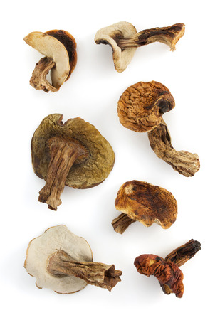 interleaved: dried mushrooms isolated on white background Stock Photo