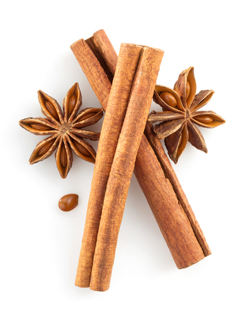 cinnamon sticks and anise star on white background photo