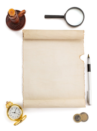 parchment scroll and supplies isolated on white background photo