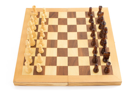 chess figures on board isolated at white background photo