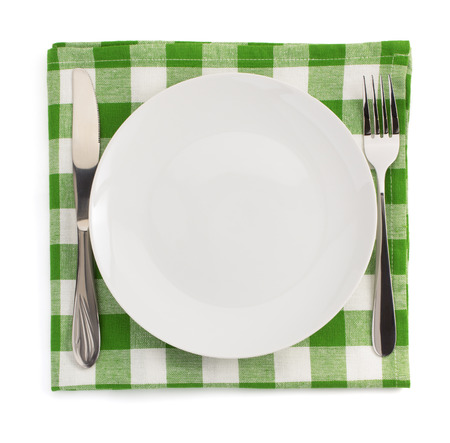 knife and fork at plate on white background photo