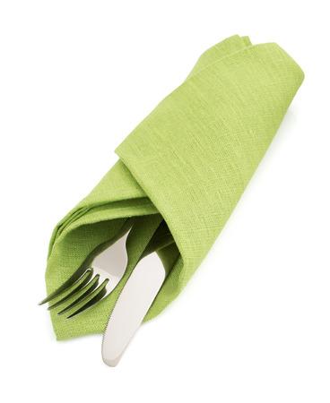 knife and fork at napkin isolated on white background Reklamní fotografie