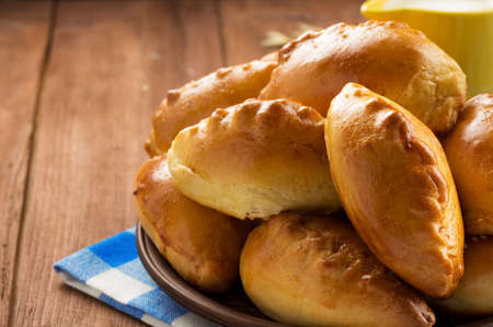 ear checked: tasty pastry on plate at wooden background Stock Photo