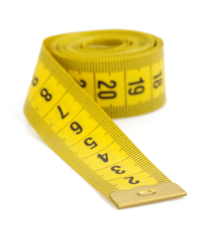 yellow measuring tape isolated on white background photo