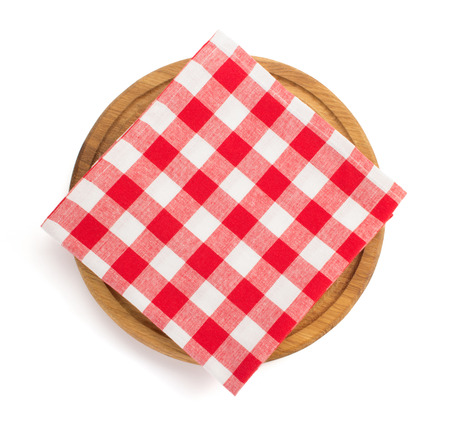 napkin at cutting board on white background photo