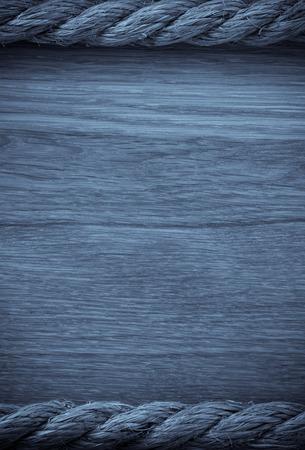 gibbet: ship ropes on wooden background