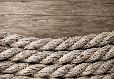 lashing: ship ropes on wooden background